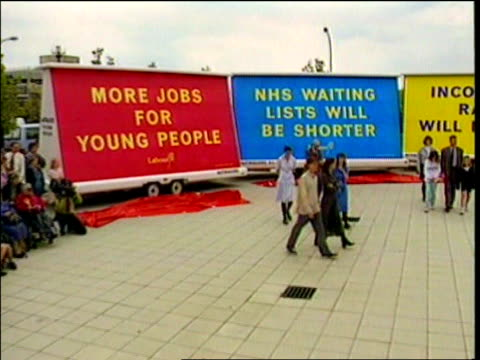 hospital waiting list figures itn ext labour party lorry hoardings set in semicircle pan to tony blair speaking on soap box during general election... - semi circle stock videos & royalty-free footage