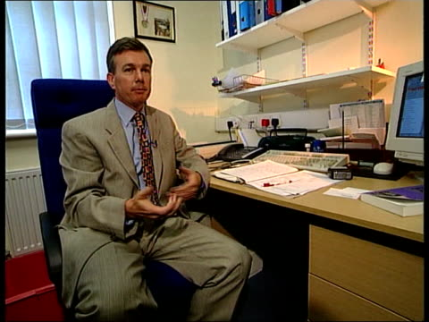 nhs hospital waiting lists itn gp dr martin wikinson speaking to man in surgery and handing him a card with the date operation booked on it cs card... - card table stock videos & royalty-free footage