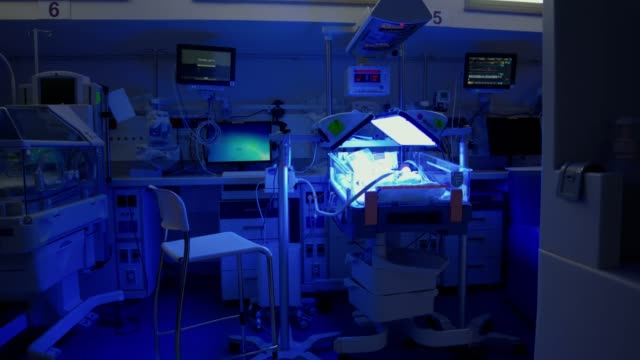hospital ward for prematurely born infants with ultraviolet lighting - luce ultravioletta video stock e b–roll