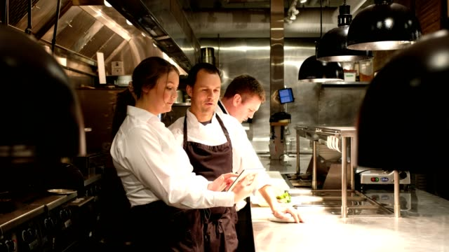 hospitality team discussing menu on a tablet - chef stock videos & royalty-free footage