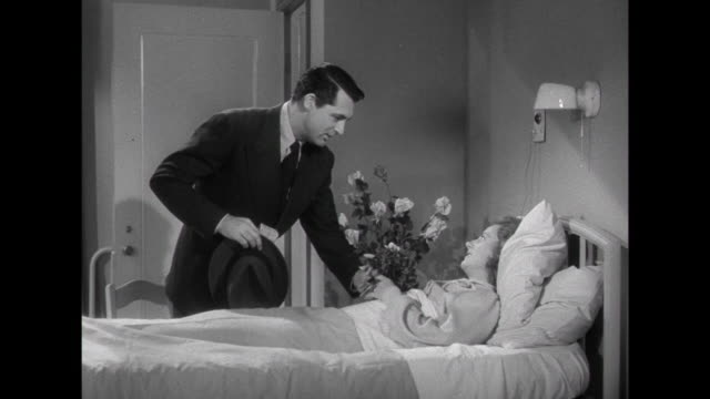 1941 hospitalized woman (irene dunne) is visited by husband (cary grant) - visit stock videos & royalty-free footage