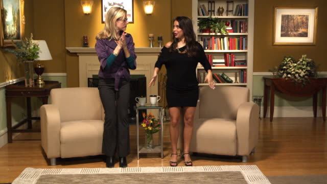 WS Host and guest on set talking and dancing, Dallas, Texas, USA