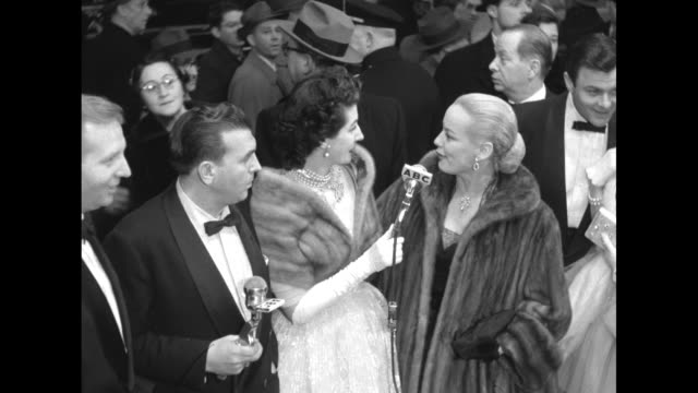 abc host dennis james hostess maggi mcnellis in a mink stole with faye emerson wearing a full length fur coat speaking about people attending... - length stock videos & royalty-free footage