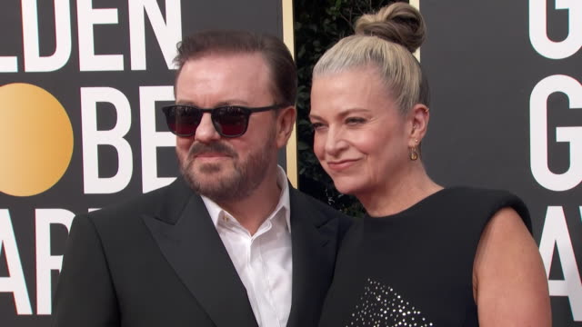 host ricky gervais poses with his partner jane fallon on the red carpet at the 2020 golden globe awards. - ricky gervais stock videos & royalty-free footage
