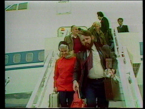 hostage jesse turner released/mid east peace; greece athens terry waite & jean waddell down plane steps towards - releasing stock videos & royalty-free footage