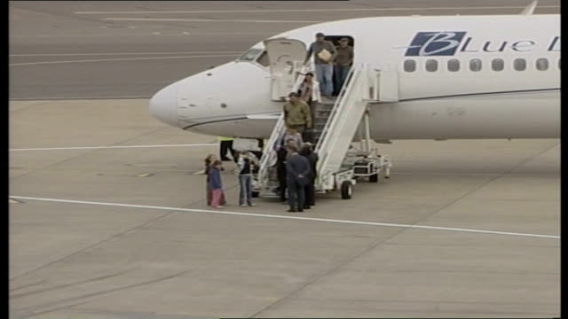 oxfordshire raf brize norton ext freed british embassy staff and their relatives along from aircraft and along tarmac - oxfordshire stock videos & royalty-free footage