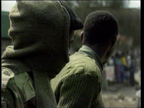 goma hutu soldier sitting in back of lorry cms hutu soldier bv hutu soldiers sitting in van cms soldier pulls mask over face la hutu soldiers sitting... - コンゴ民主共和国点の映像素材/bロール