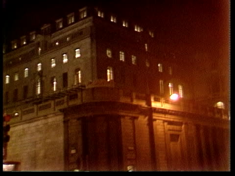 hostages; lms bank of england floodlit and with lights on lms ditto as traffic past traffic in street cas ex eng itn: 1.30mins:... - floodlit stock videos & royalty-free footage