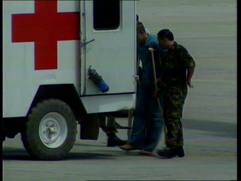 un hostages services un hostages services croatia split tms side wounded un soldier on crutches and in military pyjamas helped off aircraft un... - bosnia and hercegovina stock videos & royalty-free footage