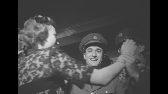 cu hostess vera zorina actress dancer dances with soldiers who cut in on one another as she is twirled around last one is a us sailor - cut video transition stock videos and b-roll footage