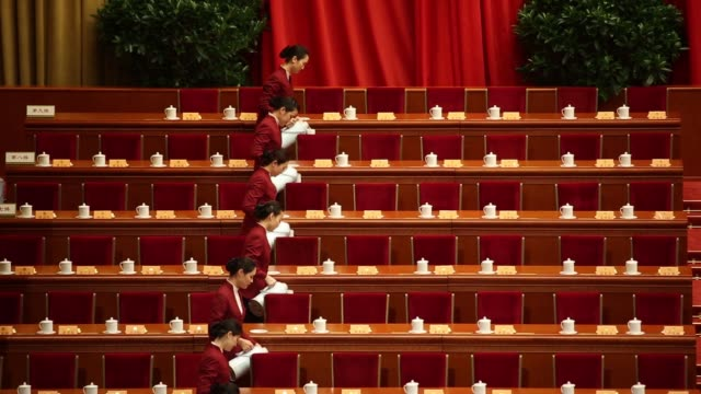 hostesses fill up cups of tea prior to the opening of the chinese people's political consultative conference at the great hall of the people in... - chinese tea set stock videos and b-roll footage