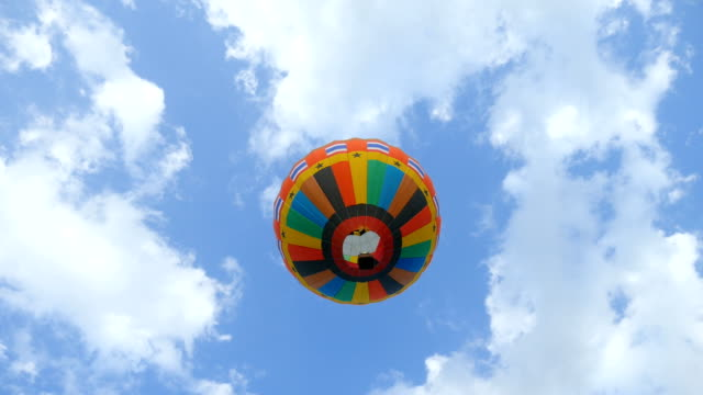 hot air balloon against the blue sky, low angle view - hot air balloon stock videos & royalty-free footage