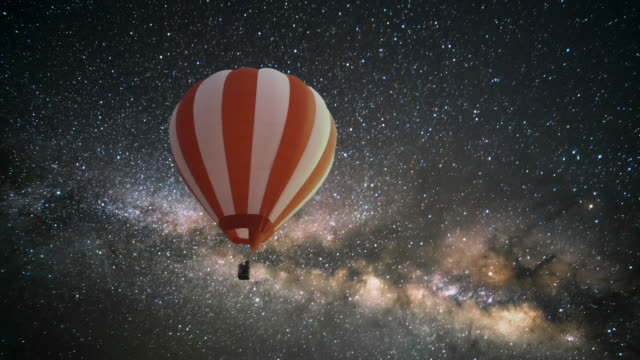 hot air balloon at night with milky way. - hot air balloon stock videos & royalty-free footage