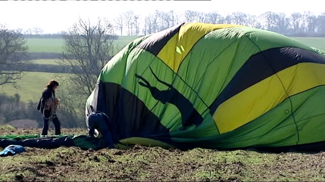 hot air balloon crashes into high voltage power lines in northamptonshire: pilot interview; day wide shot hot air balloon caught on power lines... - northamptonshire stock-videos und b-roll-filmmaterial