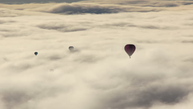 hot air balloon flight over austrian alps - group of objects stock videos & royalty-free footage