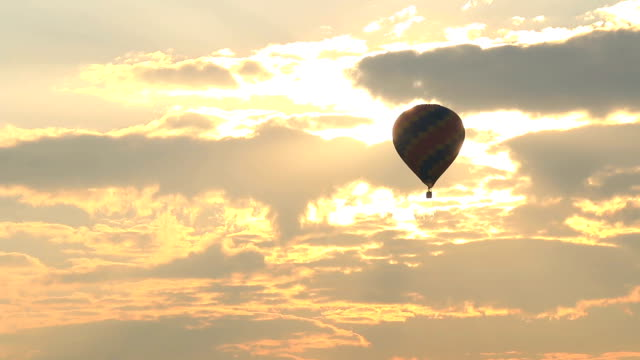 hot air balloon flying at sunrise - hot air balloon stock videos & royalty-free footage
