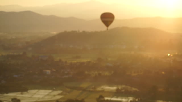 hot air balloon flying at sunrise. - basket stock videos and b-roll footage