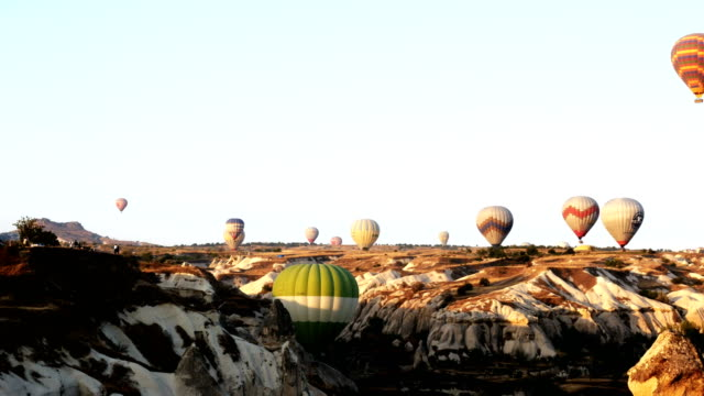 Hot air balloon flying over the fairy chimneys at Cappadocia