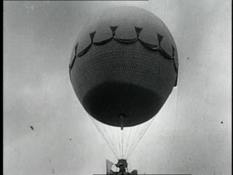 stockvideo's en b-roll-footage met hot air balloon in sky / men readying hot air balloon for flight - 18e eeuwse stijl
