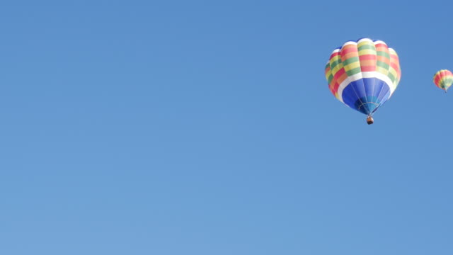 hot air balloon in the sky. - hot air balloon stock videos & royalty-free footage