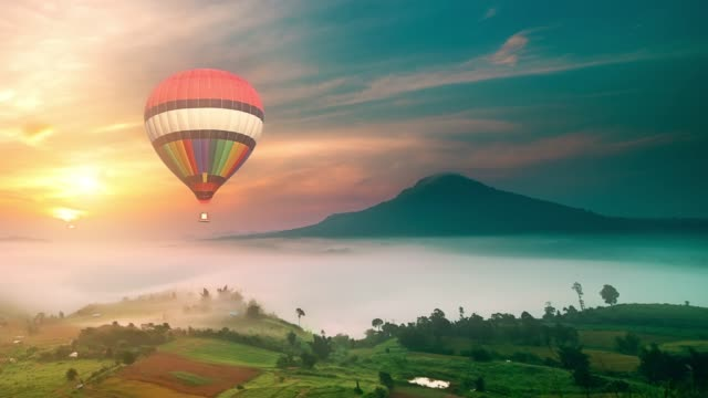 hot air balloon journey in the nature - hot air balloon stock videos & royalty-free footage