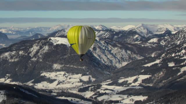 aerial ws hot air balloon over ridge / russbach, salzburg, austria - russbach stock videos and b-roll footage