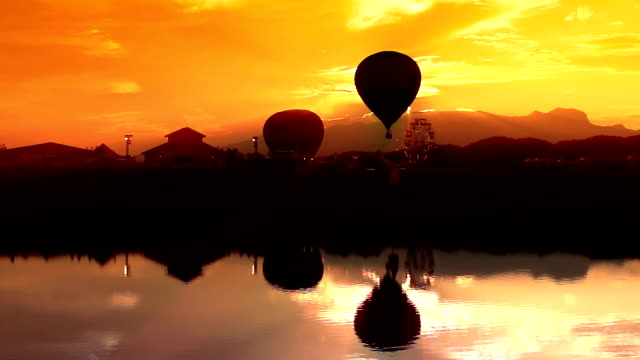 Hot Air Balloon Silhouette with water reflection