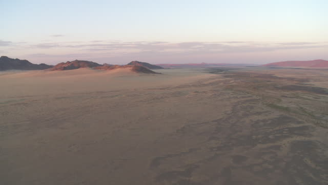 hot air ballooning - aerial view of desert dunes - non us location stock videos & royalty-free footage