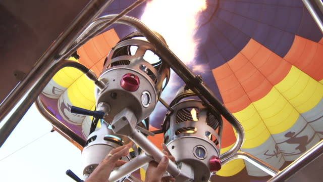 hot air ballooning - takeoff - early morning - burners blazing - making点の映像素材/bロール