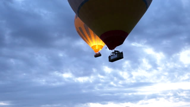 hot air balloons are flying  in goreme  in cappadocia - rock hoodoo stock videos & royalty-free footage
