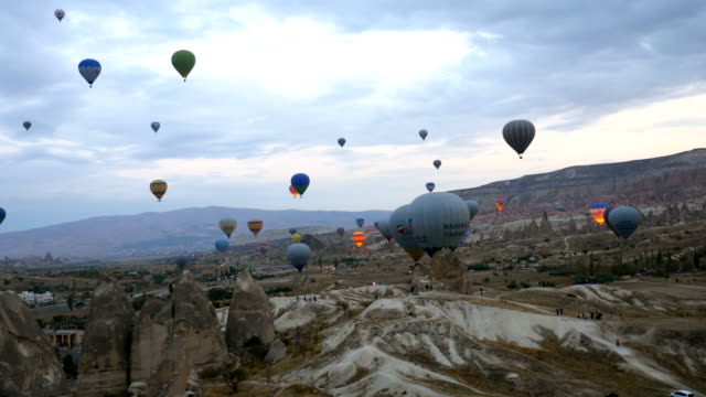 hot air balloons are flying over  goreme  in cappadocia - rock hoodoo stock videos & royalty-free footage