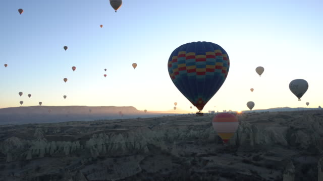 hot air balloons cave city in cappadocia, turkey - group of objects stock videos and b-roll footage