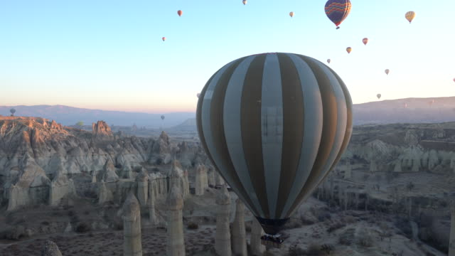 hot air balloons cave city in cappadocia, turkey - cappadocia stock videos and b-roll footage