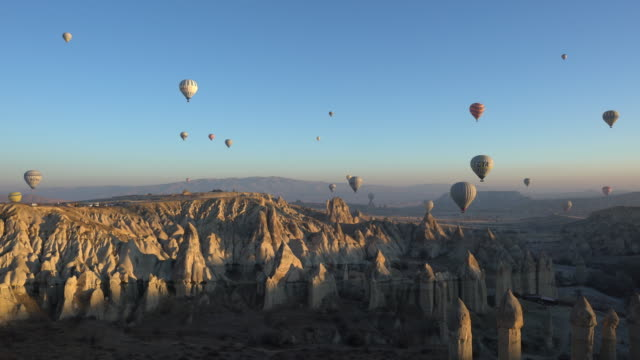 hot air balloons cave city in cappadocia, turkey - scenics stock videos & royalty-free footage