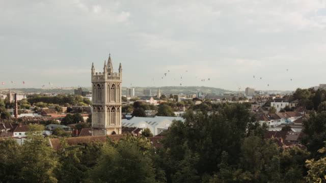 hot air balloons crossing the skyline (bristol) 2 - bristol england stock videos & royalty-free footage