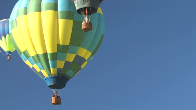 hot air balloons floating above - three objects stock videos & royalty-free footage