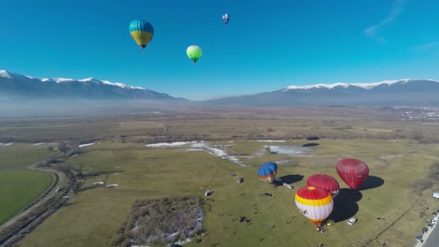 hot air balloons fly near the town of bansko some 130 kms south of the bulgarian capital sofia during an international balloon fest competition, jan.... - all around competition stock videos & royalty-free footage