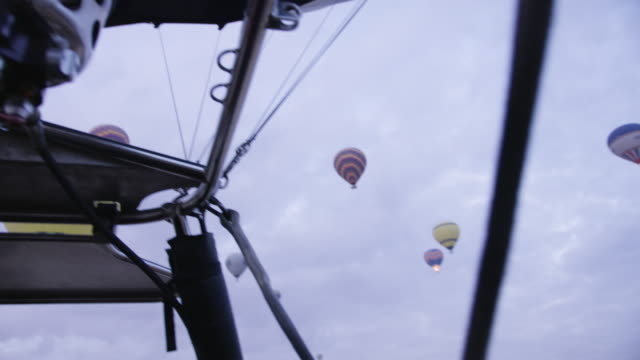 hot air balloons fly over cappadocian desert, shot with a red epic-w - turkey middle east stock videos and b-roll footage