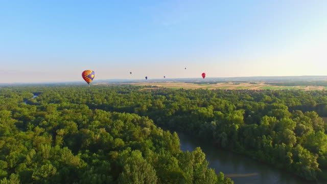 aerial hot air balloons flying above the river - hot air balloon stock videos & royalty-free footage