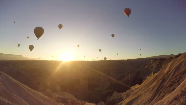 hot air balloons flying over love valleys - turkey stock videos and b-roll footage