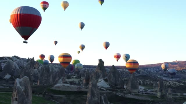 hot air balloons in cappadocia against blue sky in the early morning. - hot air balloon stock videos & royalty-free footage