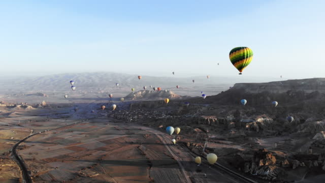 hot air balloons in cappadocia - physical geography stock videos & royalty-free footage