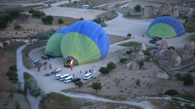 hot air balloons in preparation for flight - cappadocia, turkey - cappadocia stock videos and b-roll footage