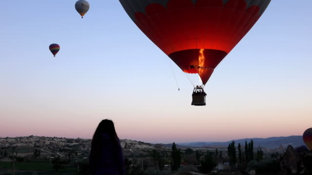 hot air balloons in the air  from within the valley in cappadocia - hot air balloon stock videos & royalty-free footage