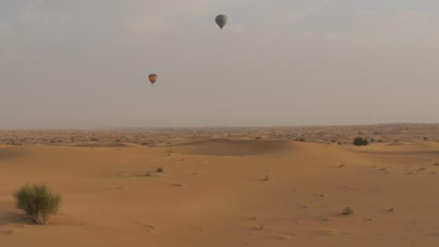 Hot air balloons in the desert on Desert Safari near Dubai, Dubai, United Arab Emirates, Middle East, Asia