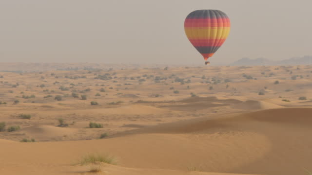 Hot air balloons in the desert on Desert Safari near Dubai, Dubai, United Arab Emirates, Middle East, Asia