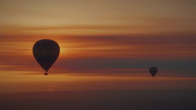 hot air balloons in the sunset - hot air balloon stock videos & royalty-free footage