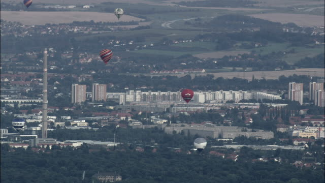Hot Air Balloons Over Dresden Suburbs  - Aerial View - Saxony,  helicopter filming,  aerial video,  cineflex,  establishing shot,  Germany