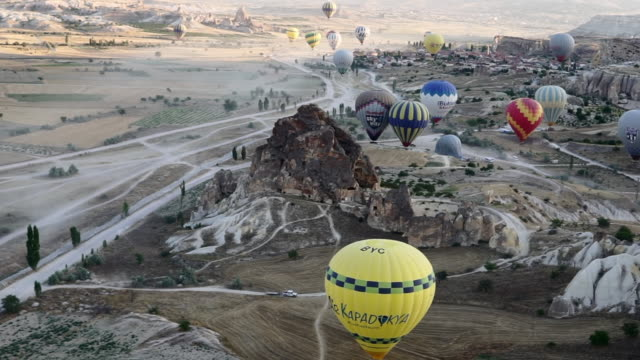 Hot Air Balloons Prepare to Ascend in Unusual Landscape - Cappadocia, Turkey