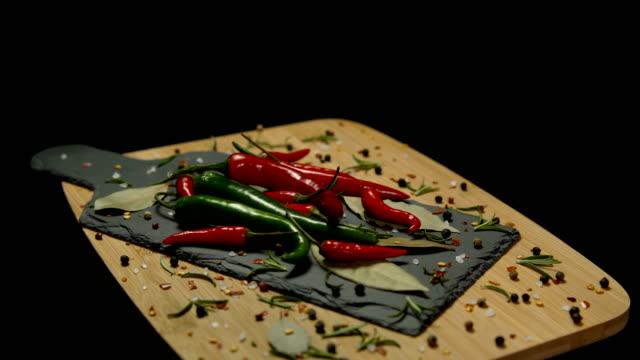 hot and spicy seasonings on rotating plate - 赤唐辛子点の映像素材/bロール